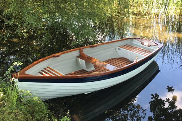 Traditional rowing boats for hire.